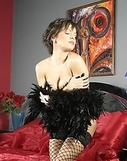 Short-haired mature porn model with a black boa
