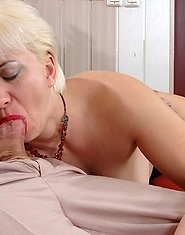 Red-stockinged blonde mommy warming up her snatch for a younger meat stick