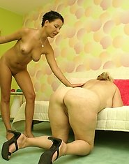 a young and mature lesbian strap on couple at play
