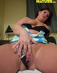 Amateur housewife having dildo fun