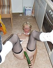 Naughty housewife gets frisky in the kitchen