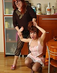 Redhead mom doesn?t miss the chance to stretch maid?s pussy with sex toy