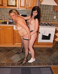 Hot babe doing a mature slut in the kitchen