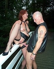 Kinky mature couple having sex in the open air