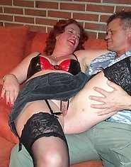 Mature couple having sex on a couch