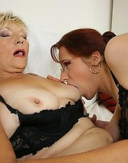 Kinky mama taking on a horny young lesbian