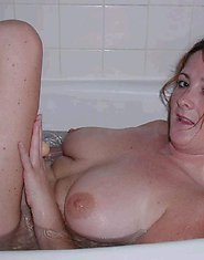 Sasha playing with big dildo while taking bath