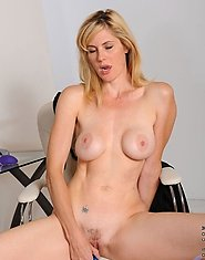 Busty milf Kate Kastle exposes her hot body while making her toy slippery