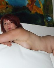 Naughty housewife getting naked in the livingroom