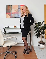 Anilos Kelly Leigh removes her office attire and flaunts her perky ass