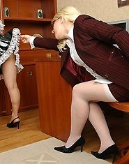 Sultry aging business woman and French maid massaging their slits at once
