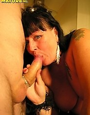Horny mature couple playing and fucking